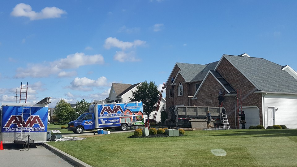 AVA Roofing & Siding working on a home in Hamburg, NY