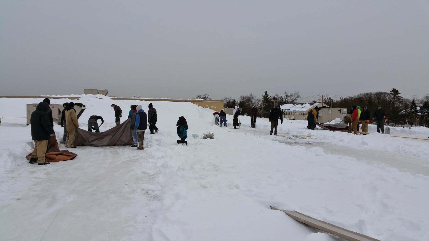 Team removing snow